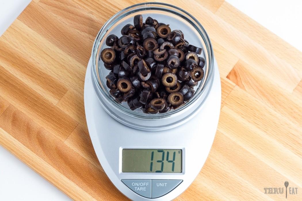 134 grams sliced black olives on a scale