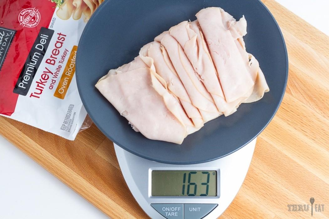 163 grams of deli turkey on a scale