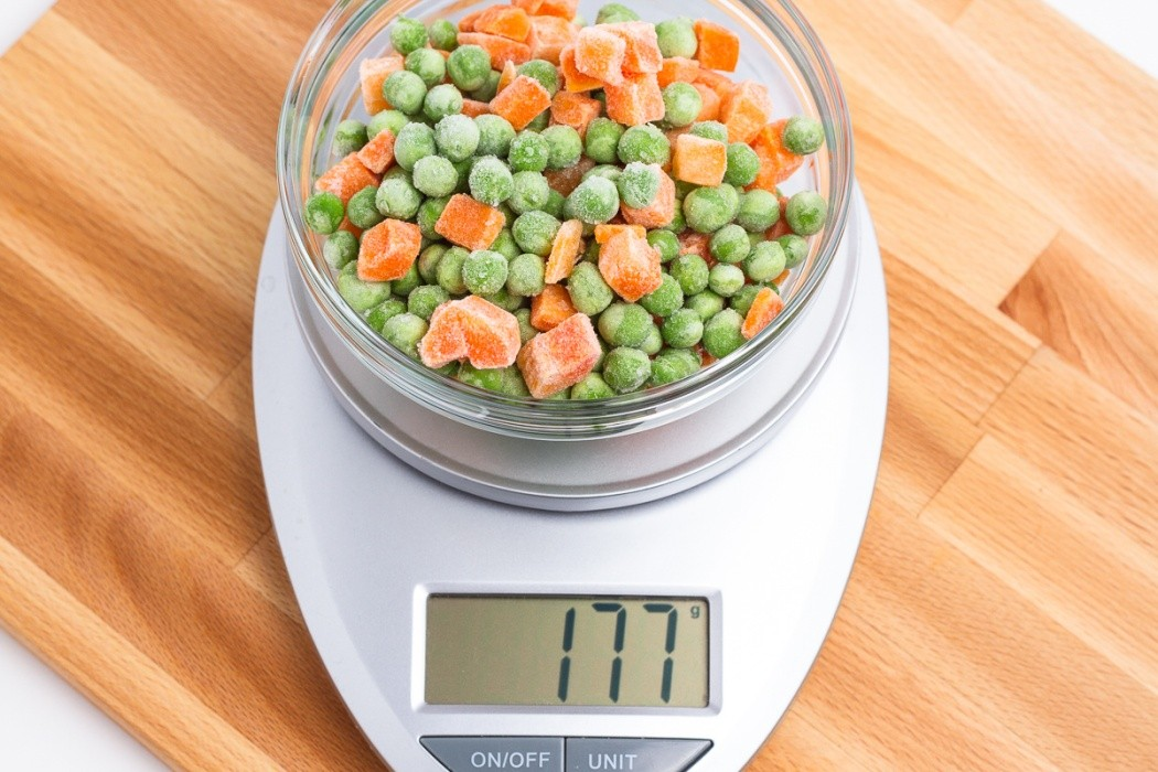 177 grams of frozen peas and carrots on a scale