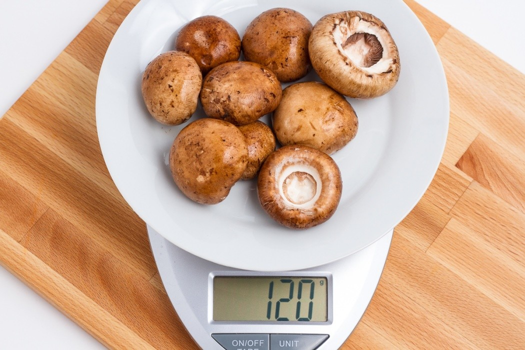 120 grams of baby bella mushroom on a scale