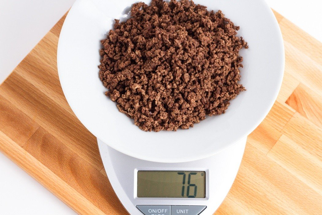 76 grams of dehydrated ground beef on a scale