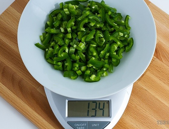 134 grams chopped jalapenos on a scale