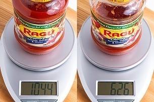 jar of Ragu pasta sauce on a scale