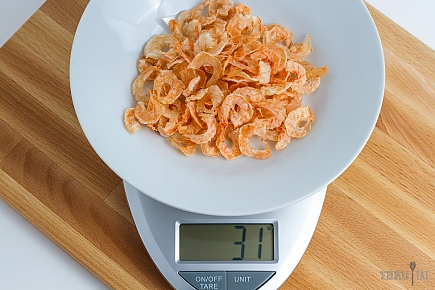31 grams of dehydrated shrimp on a scale