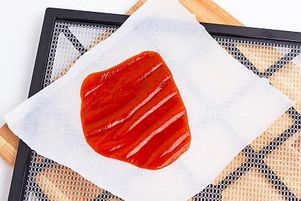 Sriracha spread on a dehydrator tray