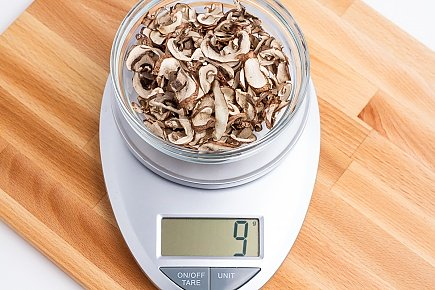 9 grams of dried baby bella mushrooms on a scale